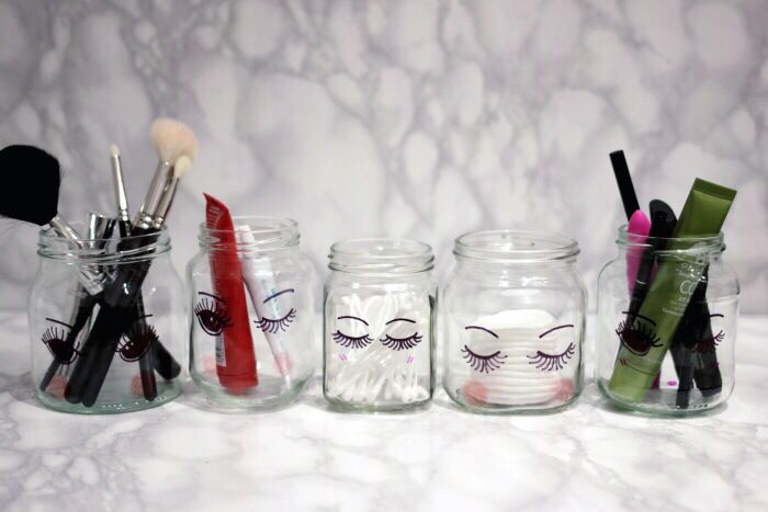 http://www.lingyeungb.com/diy-sharpie-make-up-storage-jars/